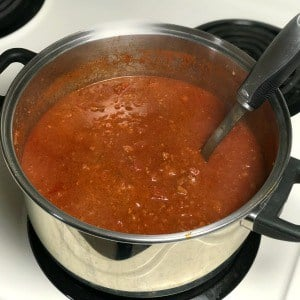 Dutch oven of Chili on a stove top