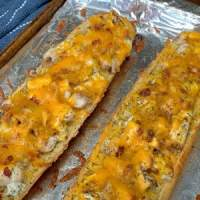 Italian Chicken Bacon Ranch Subs on garlic bread on foil covered baking sheet