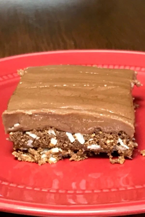 These Fudge Meltaway Cookies are too good to stop eating! A layer of grahamcracker crumbs, chocolate, butter and coconut topped with a perfectly creamy fudge makes an amazing bar cookie!