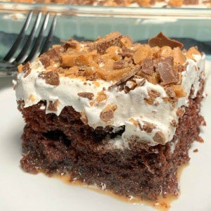 Pieces of Heath Bar Cake with butterscotch and sweetened condensed milk for moisture and whipped cream and heath bar pieces