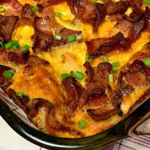 Bacon Breakfast Casserole is the perfect dish for people who love bacon, eggs, and toast.  This overnight breakfast casserole features bacon and combines easy ingredients into a hearty meal that is finished off perfectly with fresh fruit!