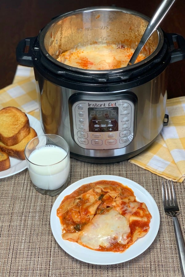 Farmhouse Instant Pot Loaded Lasagna is an easy family meal that even picky eaters like.  Using tomato juice ensures the pasta noodles are always soft and full of flavor.  We love hiding vegetables in this lasagna casserole!