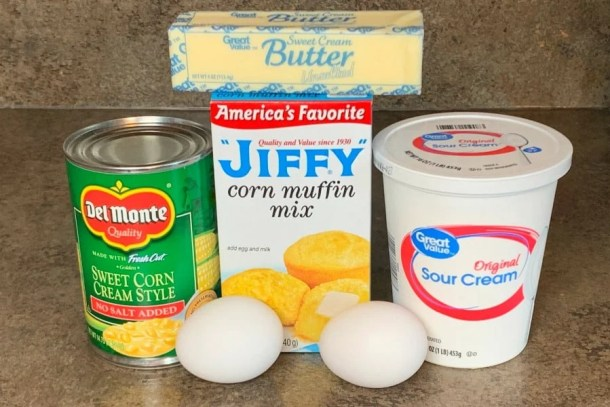 ingredients need to make jiffy corn casserole - can of creamed corn, eggs, jiffy muffin mix, sour cream and butter
