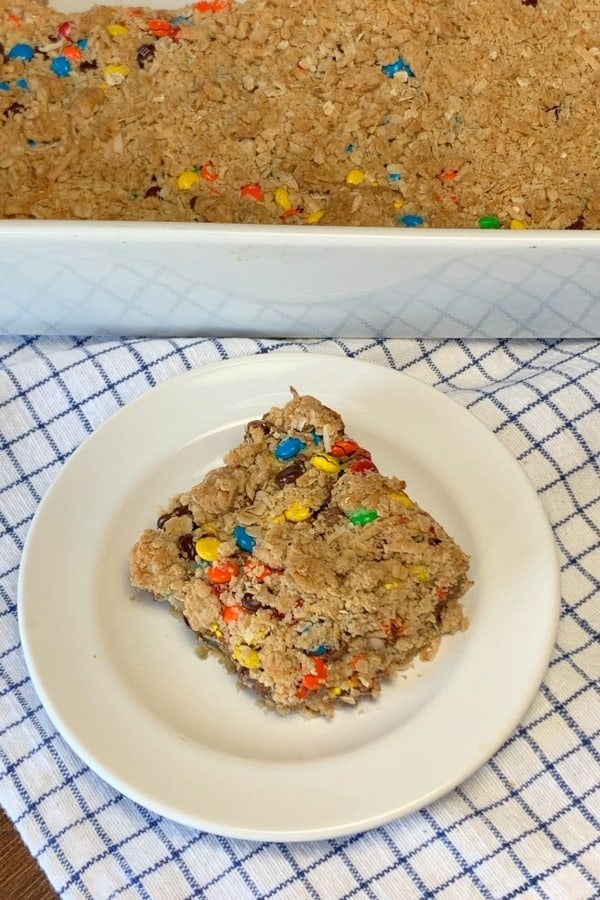 Mini M&Ms and chocolate chips on an oatmeal cookie bar