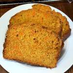 three slices of carrot bread on white plate