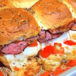 roast beef sliders with provolone cheese on Hawaiian rolls
