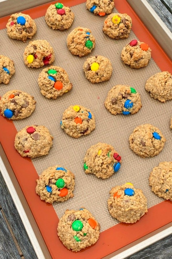 baking sheet with silpat liner full of classic monster cookies