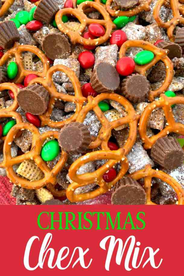 Christmas Chex Mix made with rice or corn chex mix, pretzels and chocolate candy in a decorative Christmas serving bowl is Confectioners sugar covered chex cereal, mini Reese's cups and M&Ms