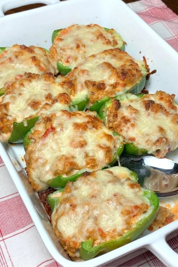 Low carb green peppers stuffed with sausage, cream cheese, tomatoes and 3 other cheeses