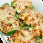 Cheese covered green bell peppers stuffed with meat and cheese and oven baked