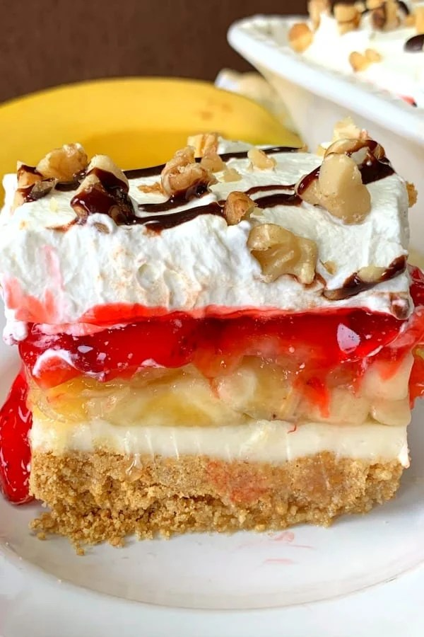 Banana split cake with strawberries and pineapple