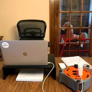 Small home office with toys in background