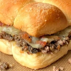 Mushroom swiss burger slider with bacon bits
