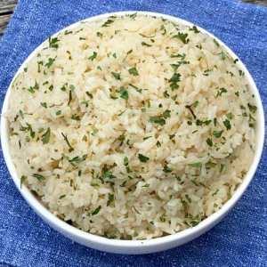 White bowl of rice pilaf on blue napkin