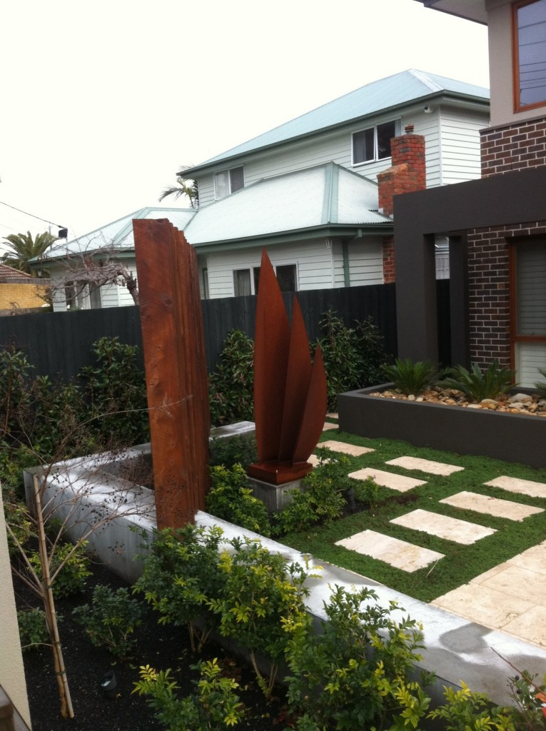 Corten steel sculpture in front yard of property by PLR Design