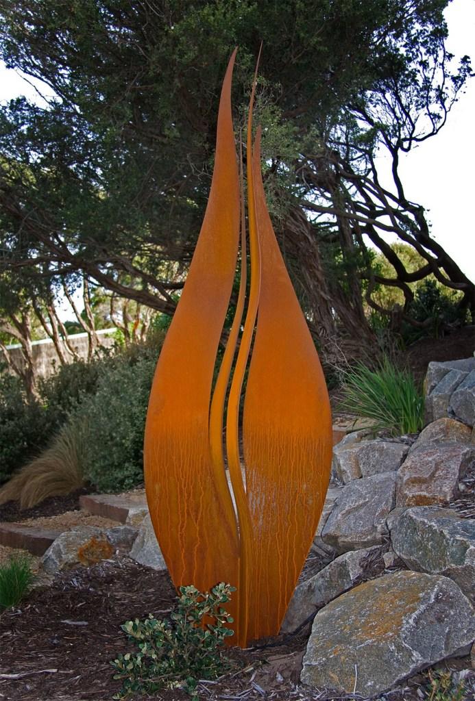 Twin Flame Corten steel sculpture in garden by PLR Design