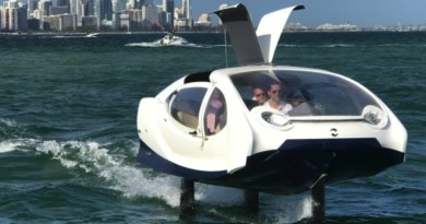 A gull wing electric hydrofoil water taxi speeding along the Miami waterfront