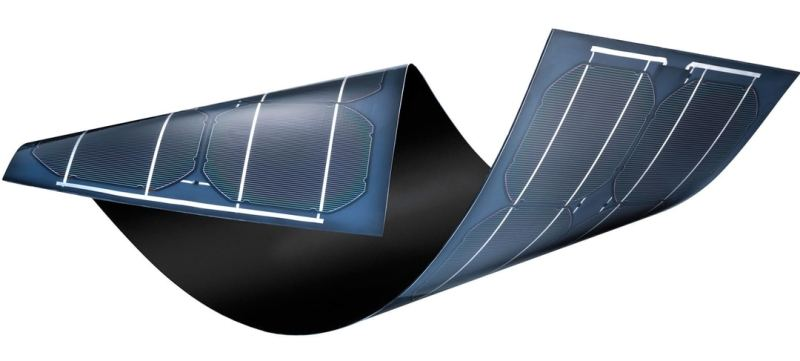 A solar panel being twisted to show its flexibility