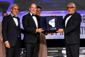 HSH Prince Albert of Monaco presents an award to the President of the Monaco Yacht Club