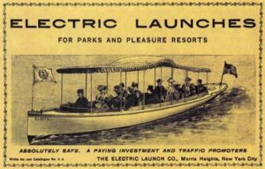 Passengers sit in a long boat with a fringed canopy on top in an ad from the early 20th century for electricallly propelled