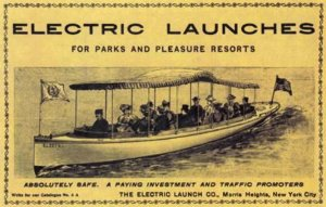 Passengers sit in a long boat with a fringed canopy on top in an ad from the early 20th century for the Elco electric boat company