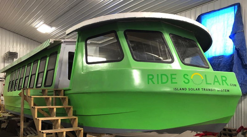 a 40 person passenger boat is being converted to a solar boat