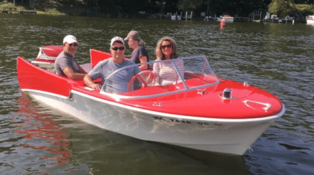 a classic bright red 1960s motorboat that has been restored