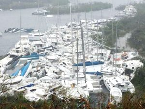 A mass of 20-50 large sail boats smashed into the shore after a hurricane