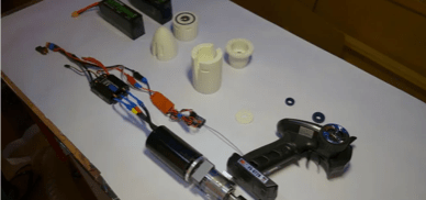 the pieces required to make an electric hydrofoil spread out on a work bench