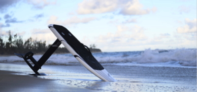 an electric hydrofoil is propped up on a beach