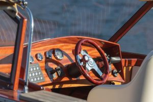 a hand crafted all wooden dashboard of a boat
