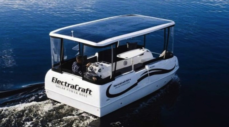 A pontoon style boat with a solar roof