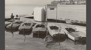 6 wooden electric boats from 1955 in a black and white photograph from the time