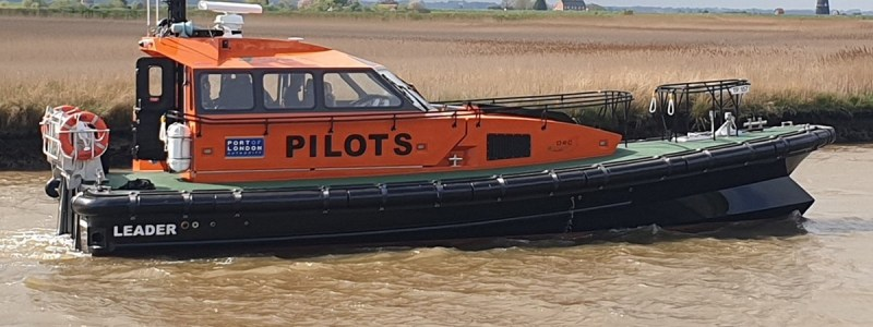 an electric pilot boat being tested on a river in England