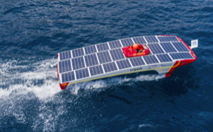 A futuristic electric boat with solar panels all along the top of its hull