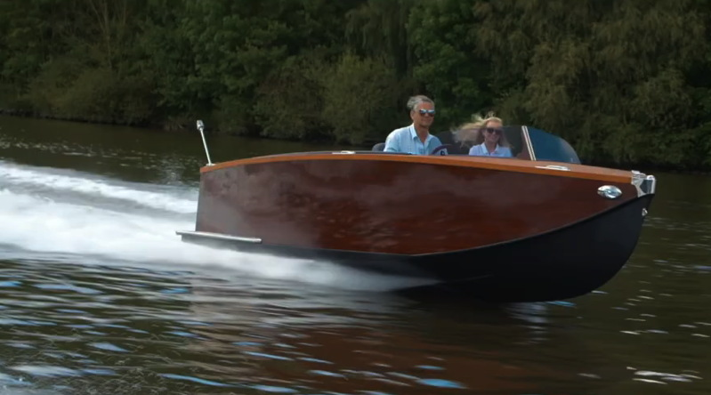 Two people going very fast in a boat with a Mercruiser electric boat motor