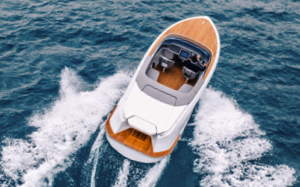 aerial view of a en electric runabout showing teak deck all around
