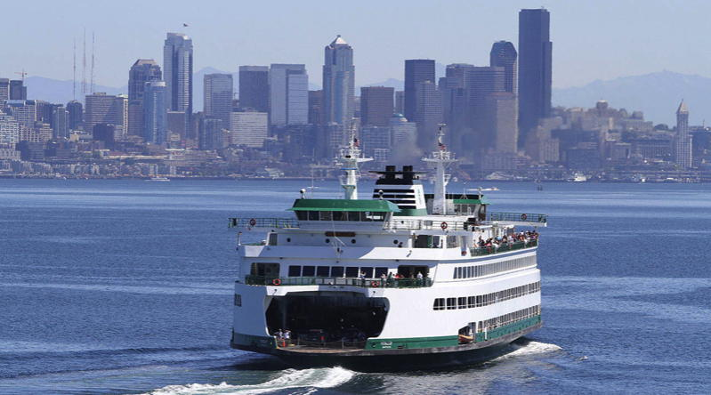 A 2500 passenger ferry in Puget Sound with Seattle in the bakground
