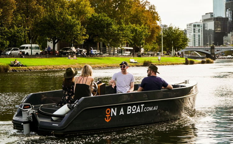 A group of people in an electric boat in Melbourne Australia