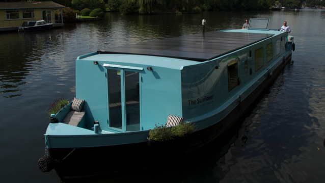 Canal boat in London, England with solar panels on the roof