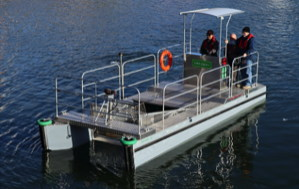 all electric boat with scoop at front to collect waste