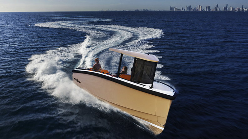A Dutchcraft electric boat speeds along the sea with a city skyline far in the bakground