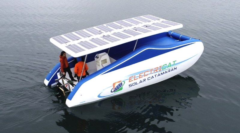 inflatable solar catamaran showing the solar roof and electric motor