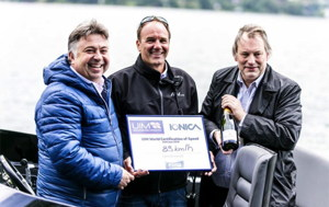 Electric peed boat record holder being presented with certificate