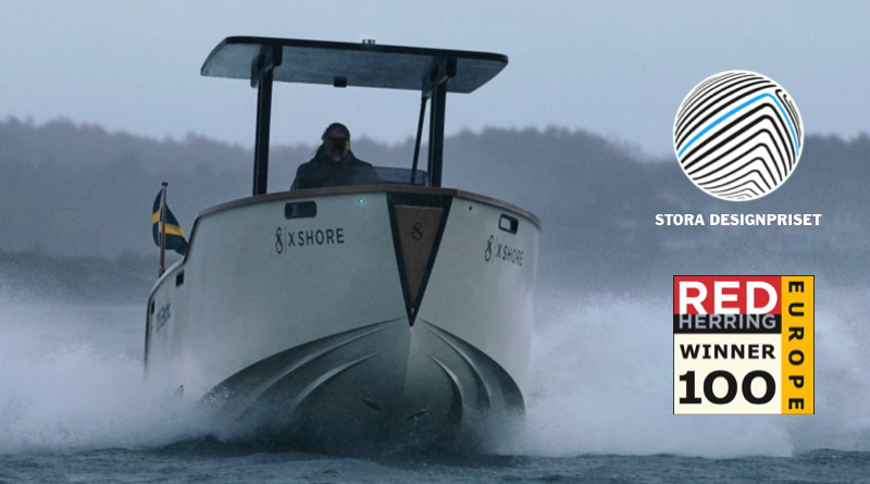 X Shore electric boats Eelex 8000 model riding in the water with logos of the awards it won