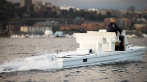 electric boat package: Pure outboard on a rowing coach boat travelling a long a river