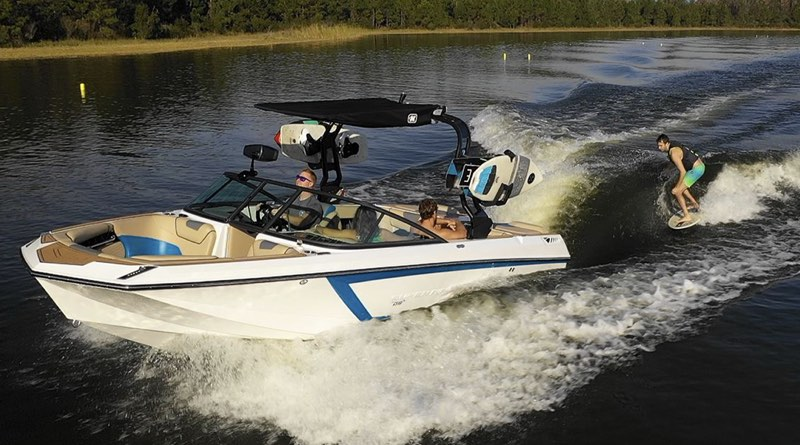 Nautique electric boat pulling a wakeboarder