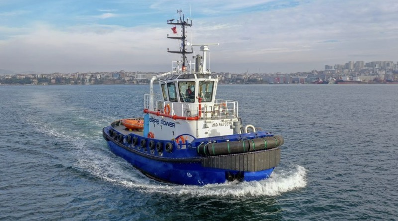 all electric tugboat sailing in harbour