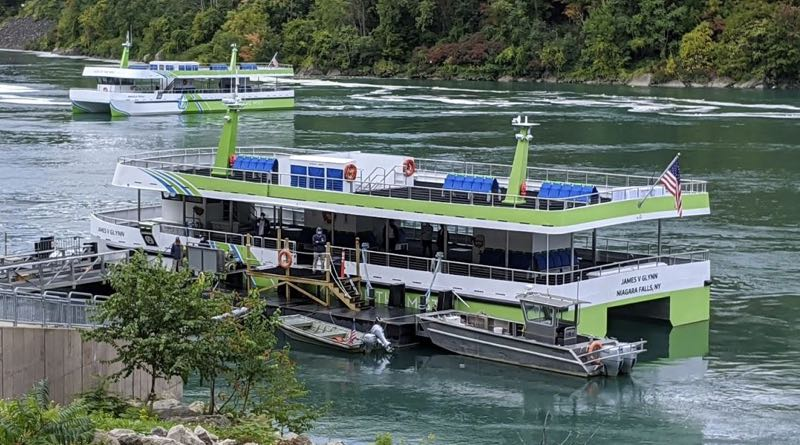 2 Niagara Falls electric ferries waiting for passengers to board in the gorge of the Niagara River, downstream from the Falls