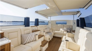 electric tenders interior with white leather upholstered seating for 12